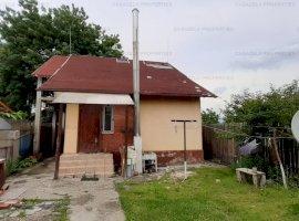 Casa si teren de 1006 mp in Puchenii Mari, Sat Pietrosani, Prahova.